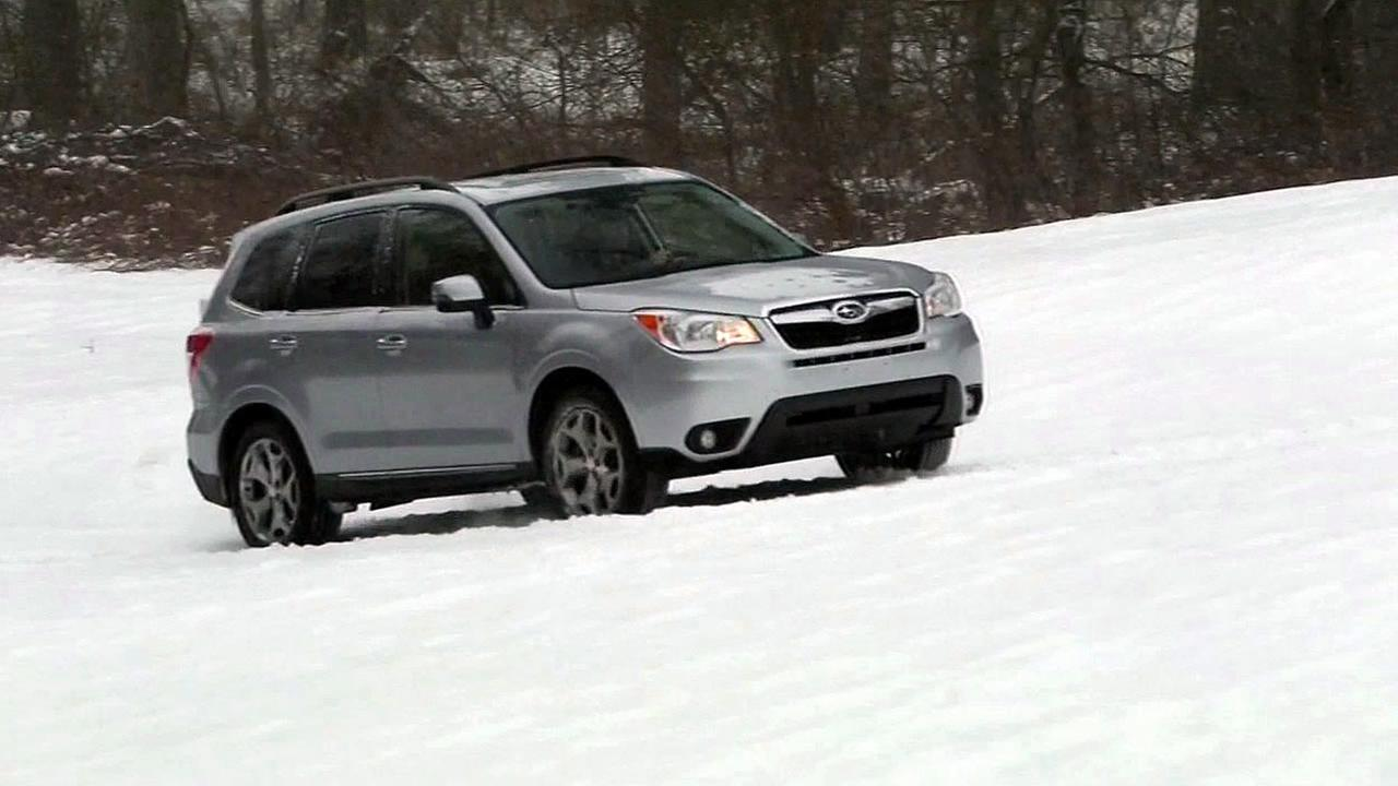 A Subaru Forester is seen driving up a hill in the snow in this undated image.