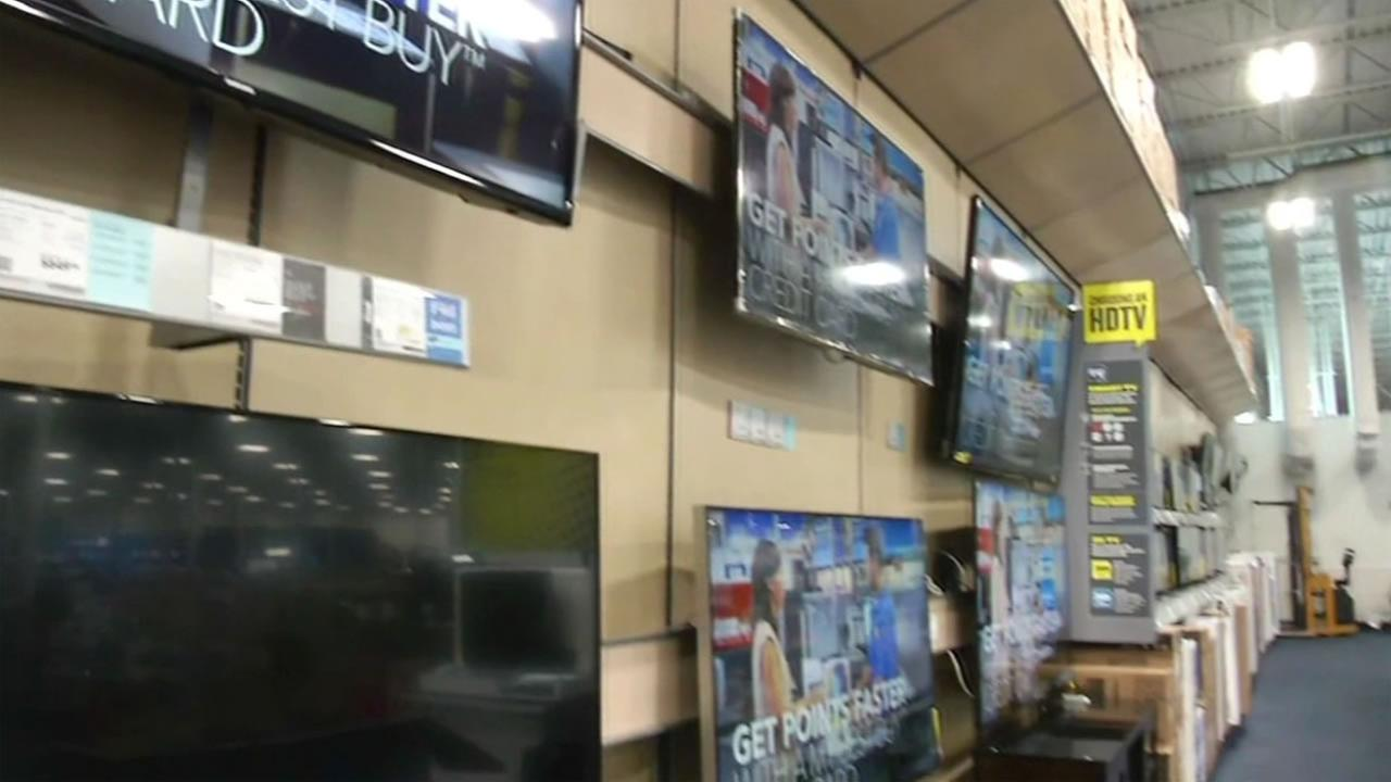 This undated image shows TVs for sale at a Best Buy.