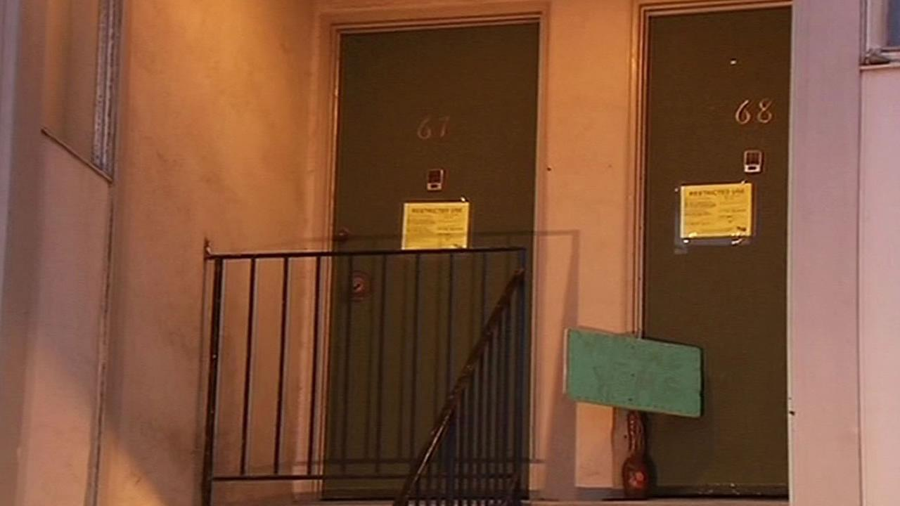 yellow tags on doors of 310 Esplanade in Pacifica