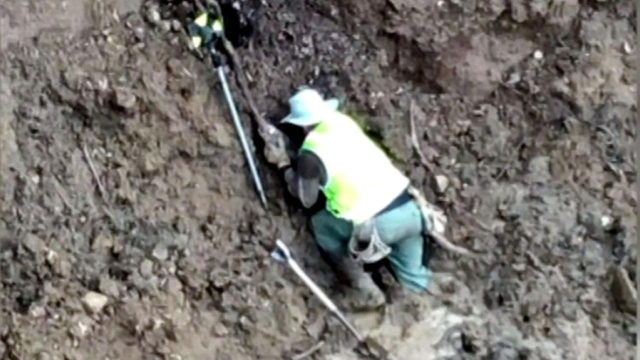 geological surveyor stuck in the mud in Oakland