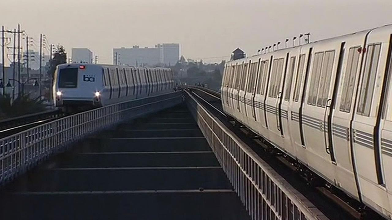BART trains moving along the track
