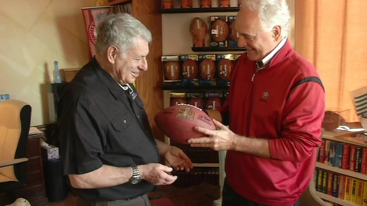 Super fan Larry Jacobson is seen holding a Super Bowl 50 football with his name on it in this undated image.
