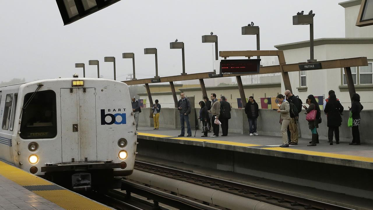 Bay Area Rapid Transit passengers wait to board a train at the Fruitvale BART station Tuesday, Oct. 22, 2013, in Oakland, Calif. (AP Photo/Ben Margot)