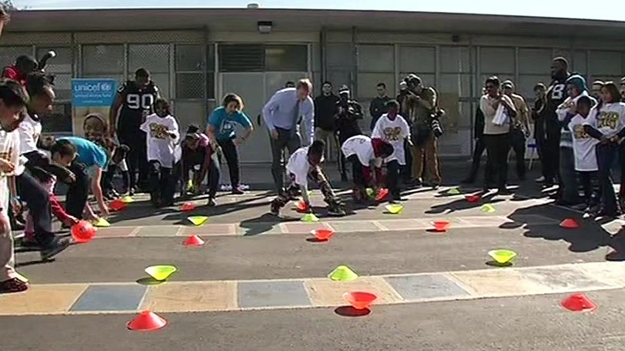 NFL Commissioner Roger Goodell exercises with children in San Francisco, Calif. on Thursday, February 4, 2016.