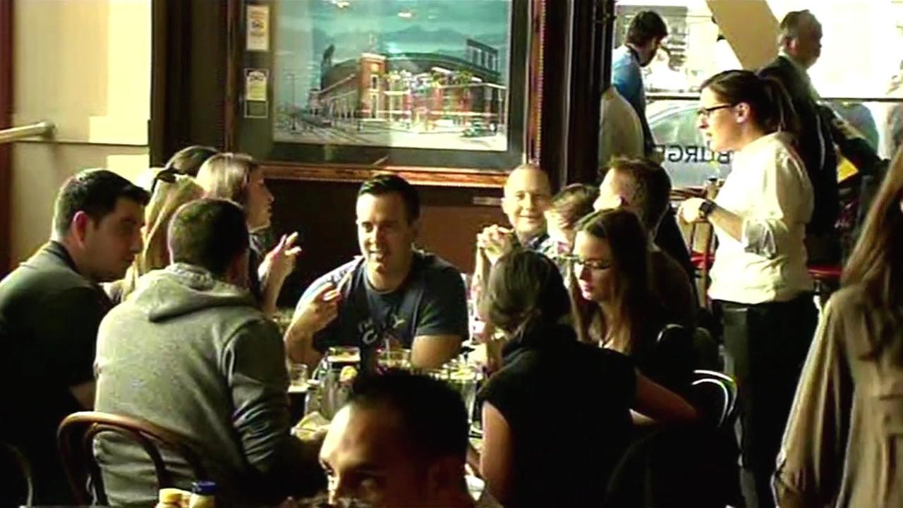 A group of people are seen eating at a restaurant in San Francisco, Calif. in this undated image.