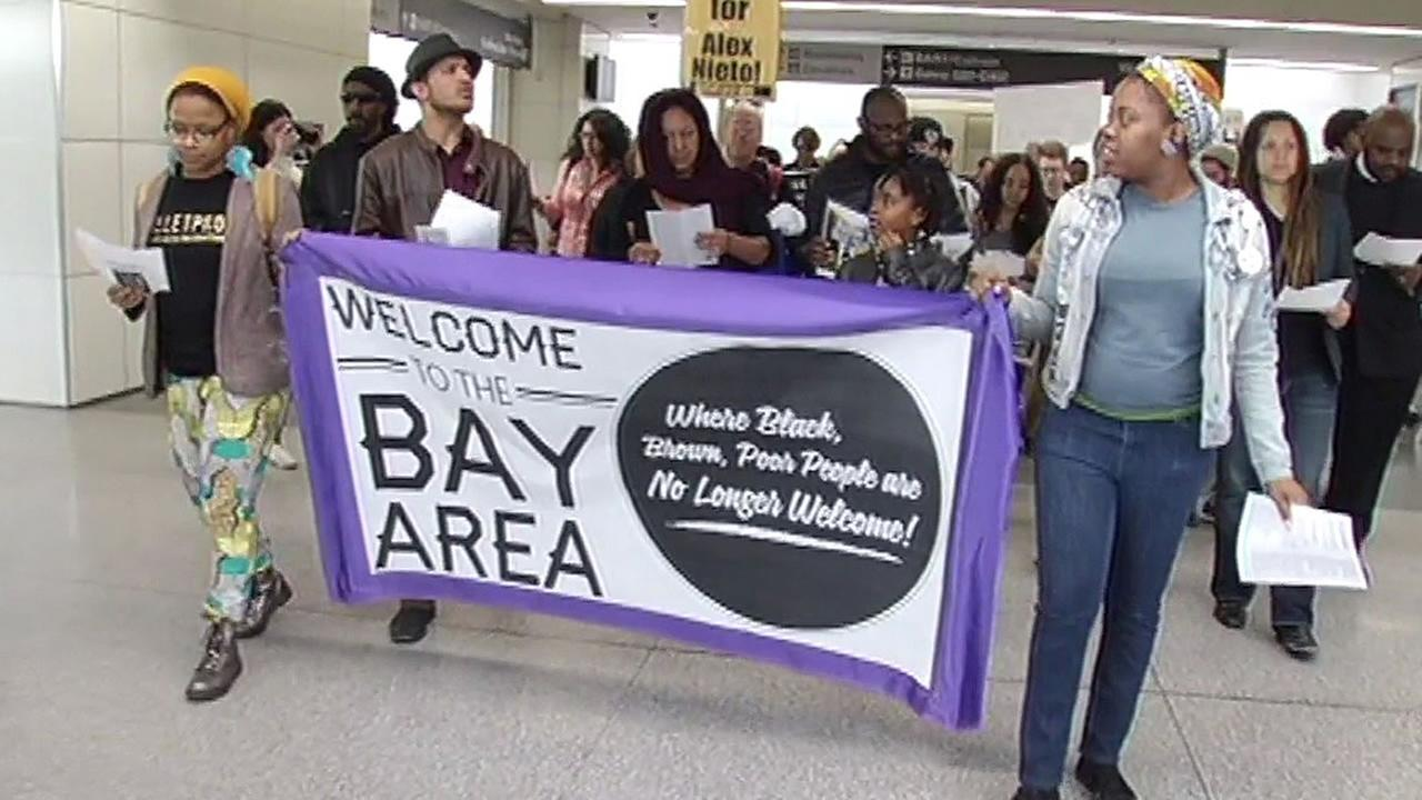 Anti-Police Terror Project marches with signs in SFO