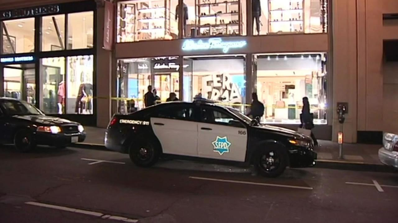 Police respond to a robbery at a high-end store called Ferragamo in San Francisco, Calif. on Tuesday, February 9, 2016.