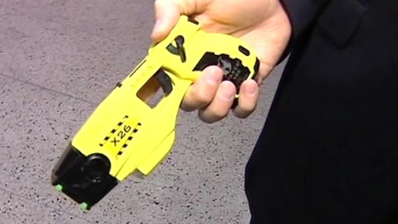 A Taser is held in this undated image.