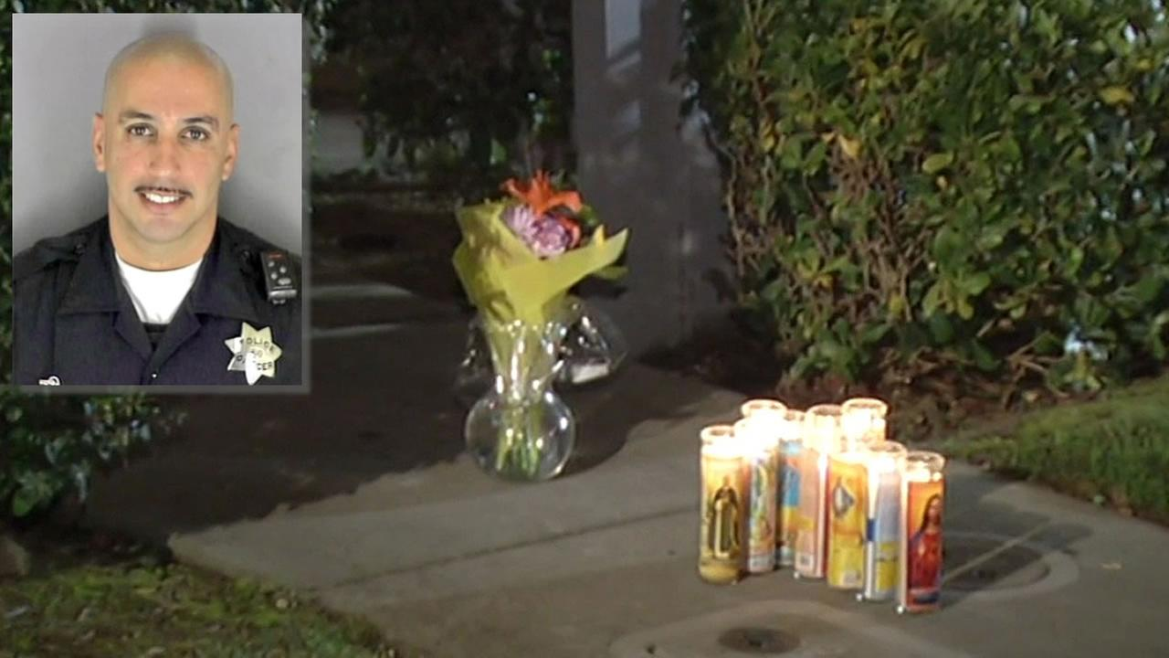 Officer Gus Vegas and candles outside his home