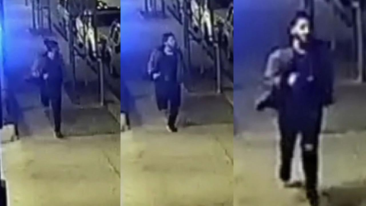 surveillance video of attacker near UC Berkeley running down the street