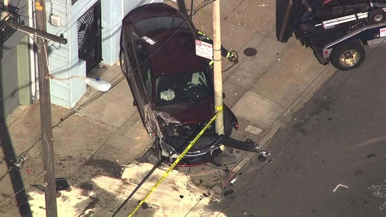 Emergency crews respond after a car crashed into a building in San Francisco, Calif. on Thursday, February 25, 2016.