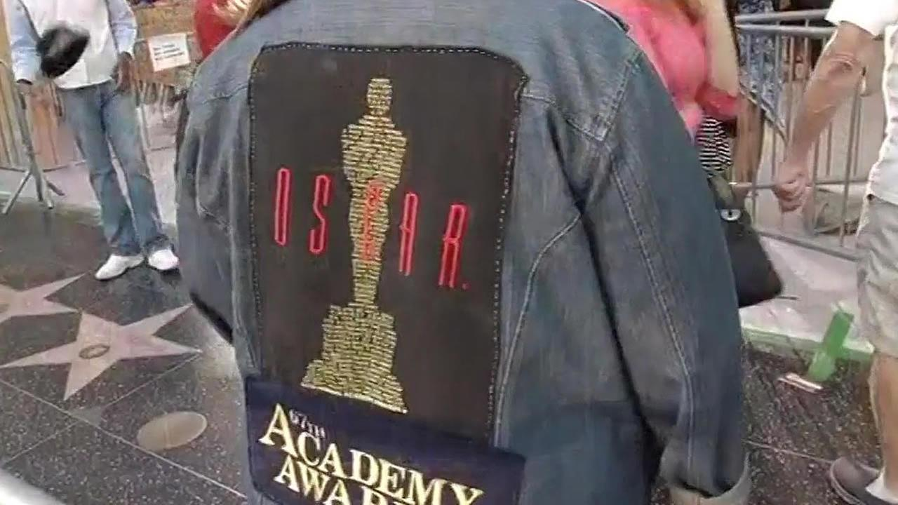 Oscar fan has a jean jacket covered in Oscar patches