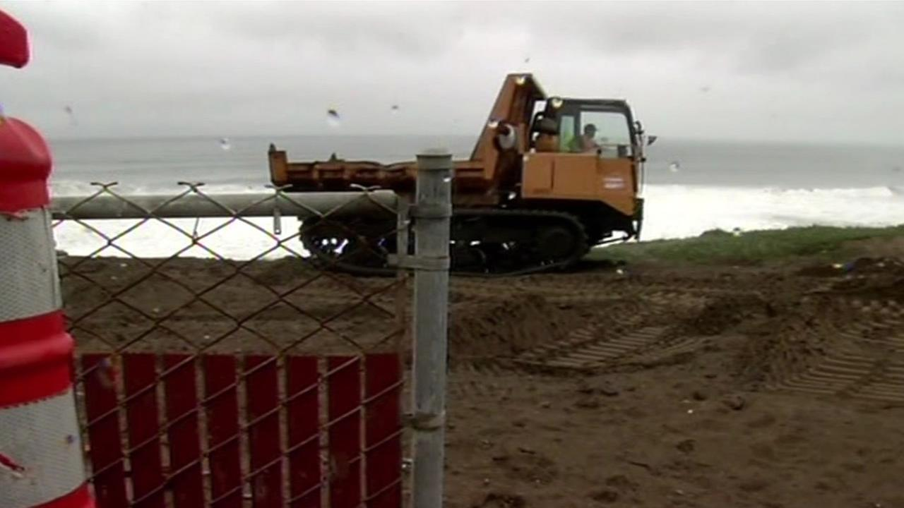 Construction crews are fighting erosion by shoring up Pacificas waterfront with dirt and rock on Friday, March 4, 2016.KGO-TV