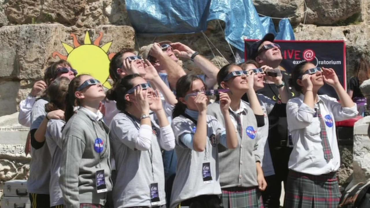 FILE: A group of students prepare to watch an eclipse.