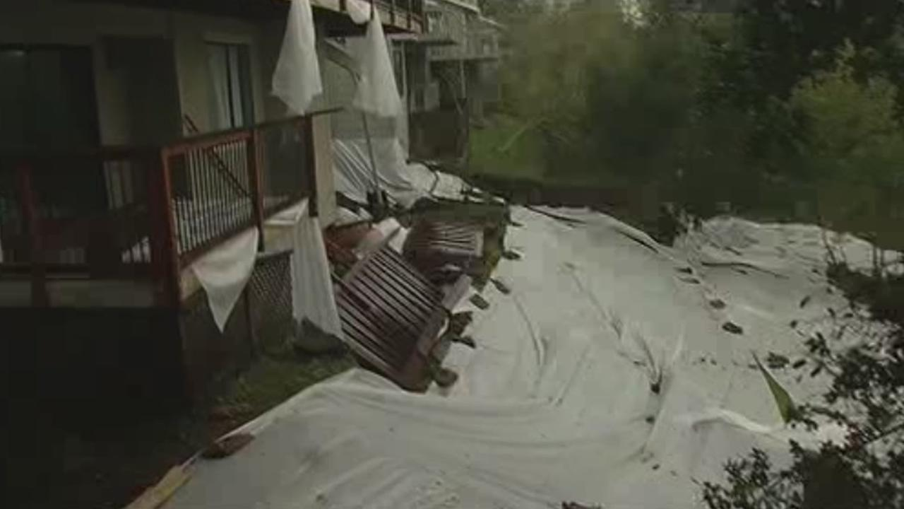 A tarp has been placed over a hillside in Moraga, Calif., to keep homes from sliding on Saturday, March 13, 2016.KGO-Tv