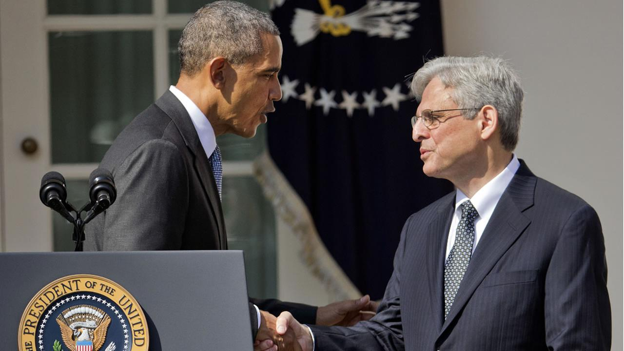 Federal appeals court judge Merrick Garland, right, shakes hands with President Barack Obama in the Rose Garden of the White House, in Washington, Wednesday, March 16, 2016.