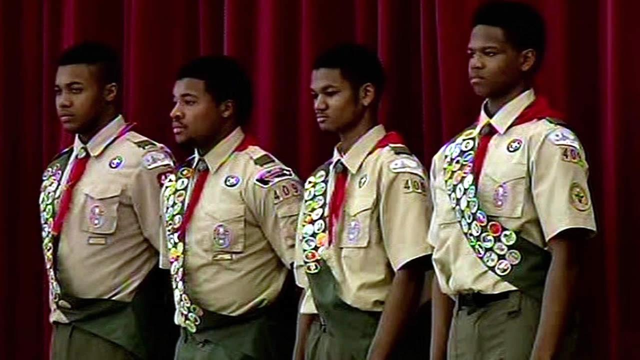 A group of East Oakland boy scout troops are seen graduating to Eagle Scout status in this undated image.