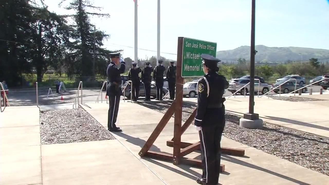 San Jose police officers give a salute at highway dedication ceremony for fallen Officer Michael Johnson in San Jose, Calif.  March 24, 2016.
