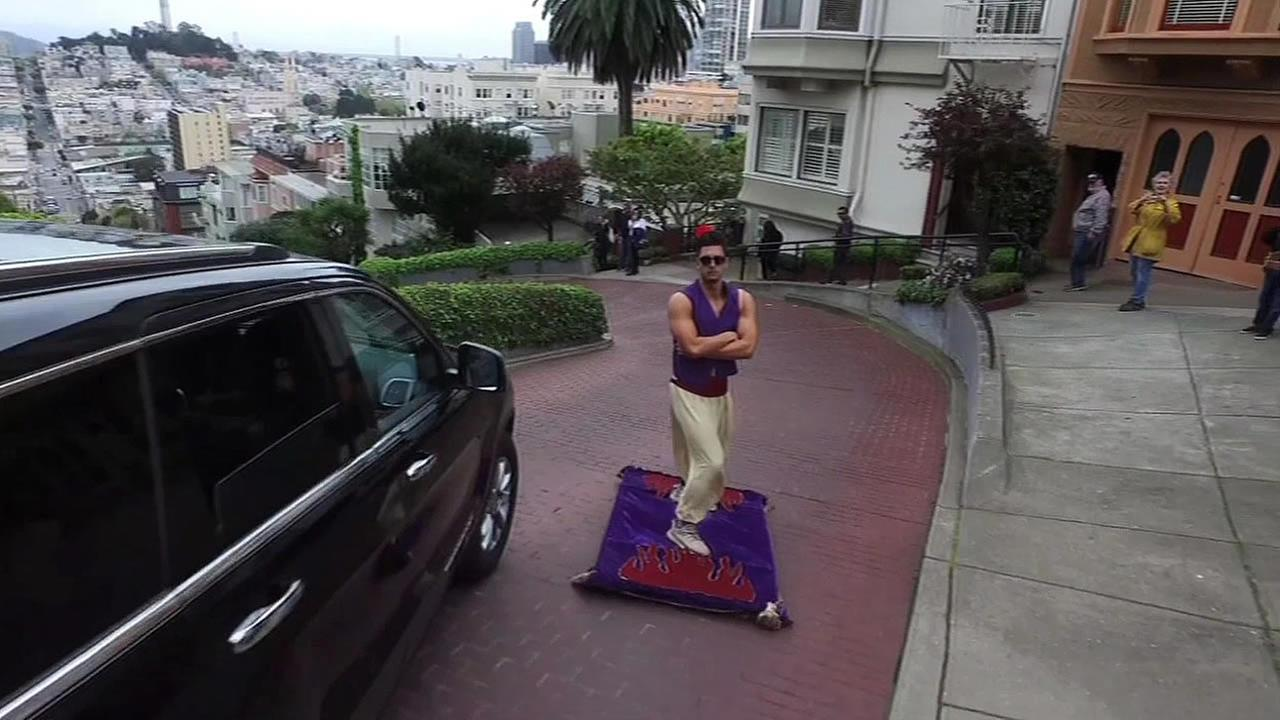 A man dressed as Aladdin rides a magic carpet in San Francisco, Calif. on Thursday, March 24, 2016.