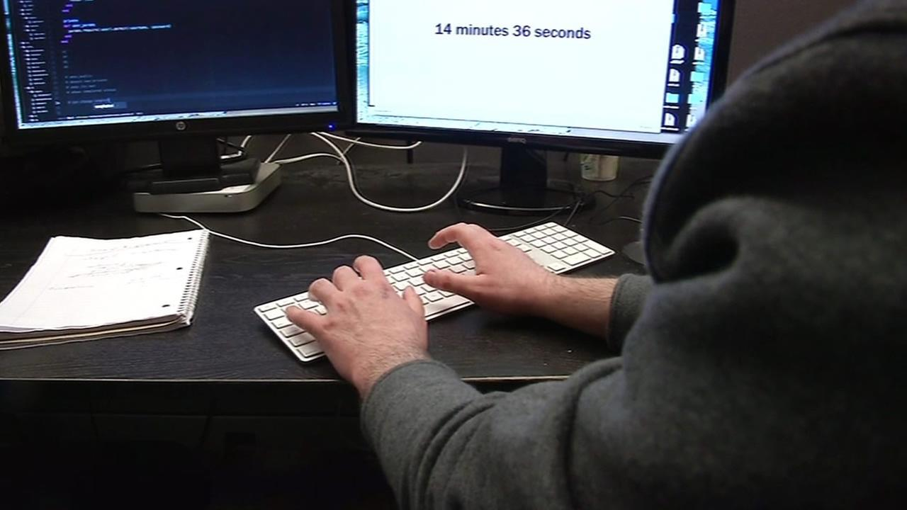 A man is seen typing on a computer in this undated image.