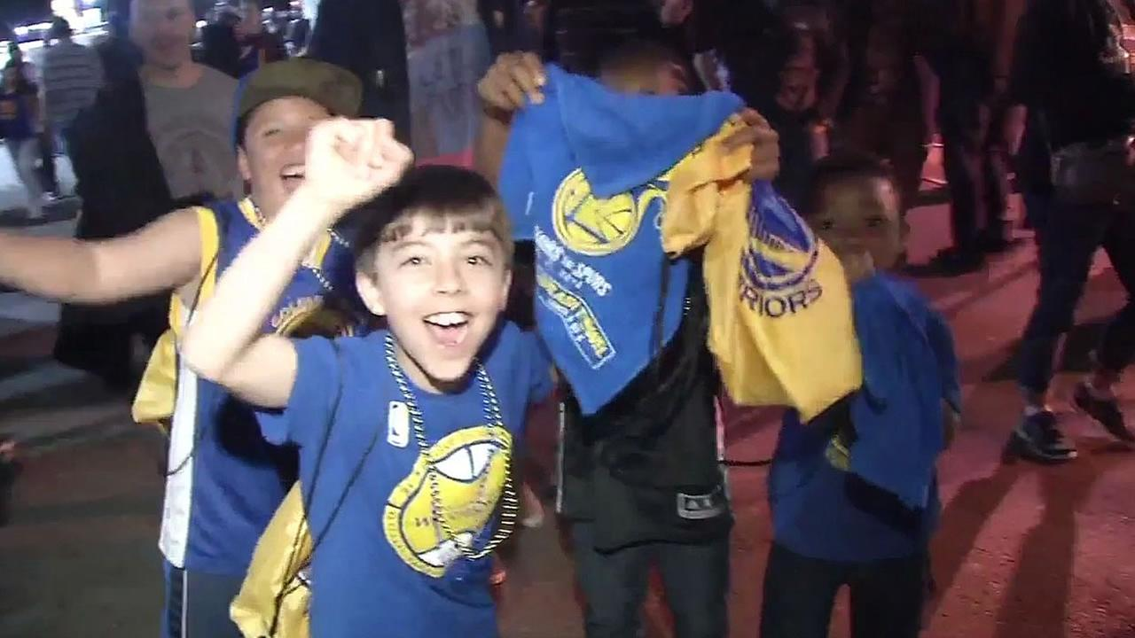 Young Golden State Warriors fans celebrating after the Dubs beat the San Antonio Spurs in Oakland, Calif on Thursday, April 7, 2016.