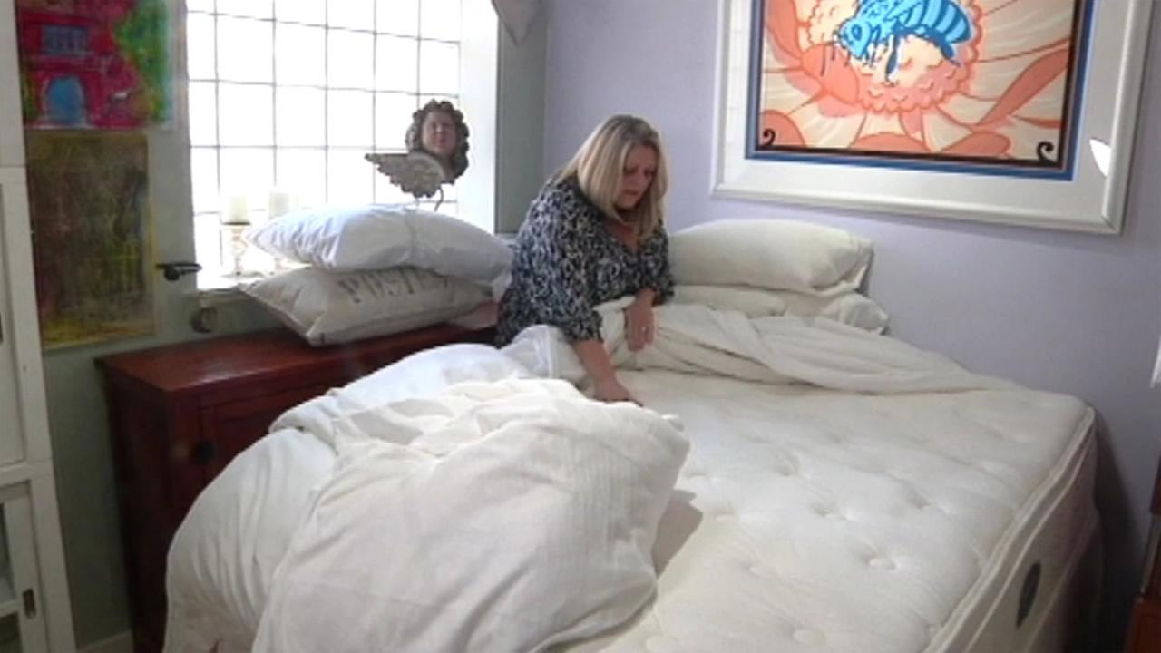 A woman is seen looking at her her bed in this undated image.