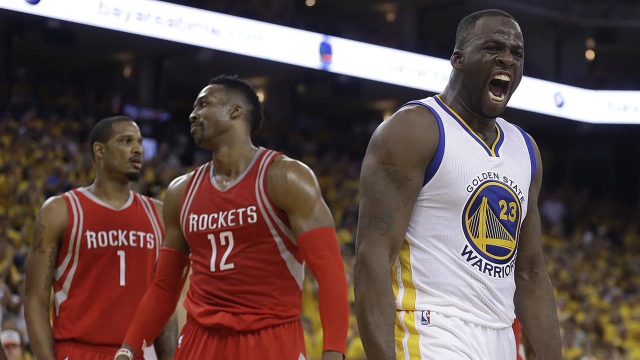 Golden State Warriors Draymond Green, right, yells after being fouled by Houston Rockets Dwight Howard (12) in Game 2 of a NBA basketball playoff series April 18, 2016.