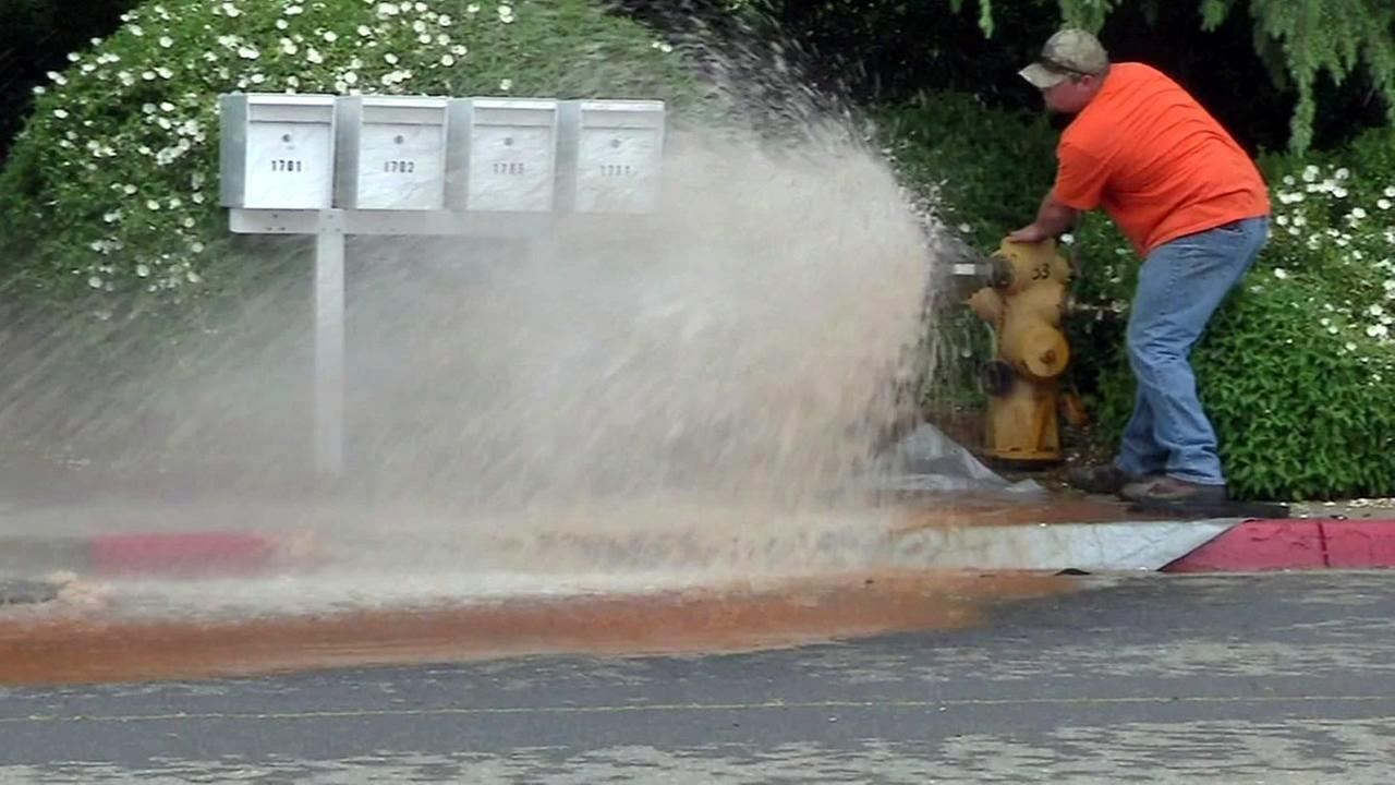 A hydrant blasts water onto a street in this undated image.
