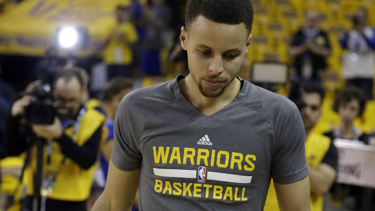Warriors Stephen Curry walks on the court for practice prior to Game 2 of their playoff s against the Houston Rockets April 18, 2016, in Oakland, Calif. (AP Photo)