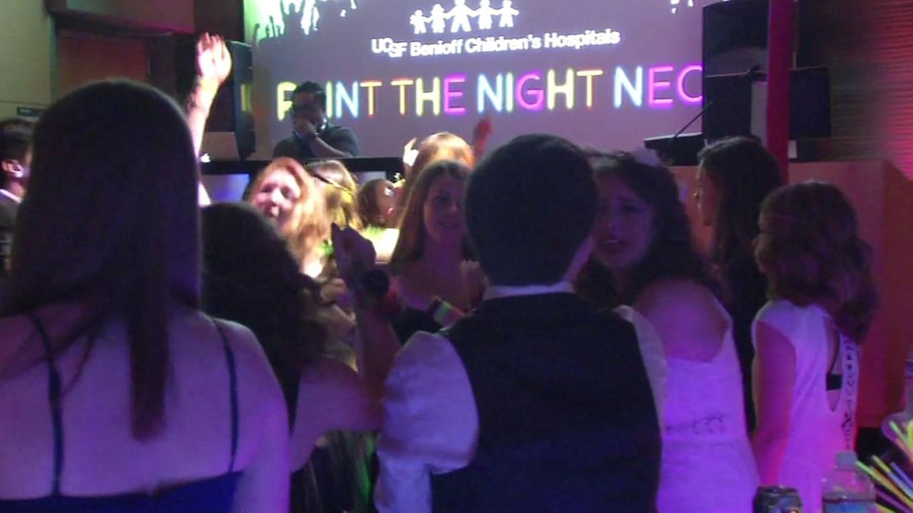 This image shows teenagers dancing at the UCSF Benioff Childrens Hospital Mission Bay in San Francisco prom April 23, 2016.