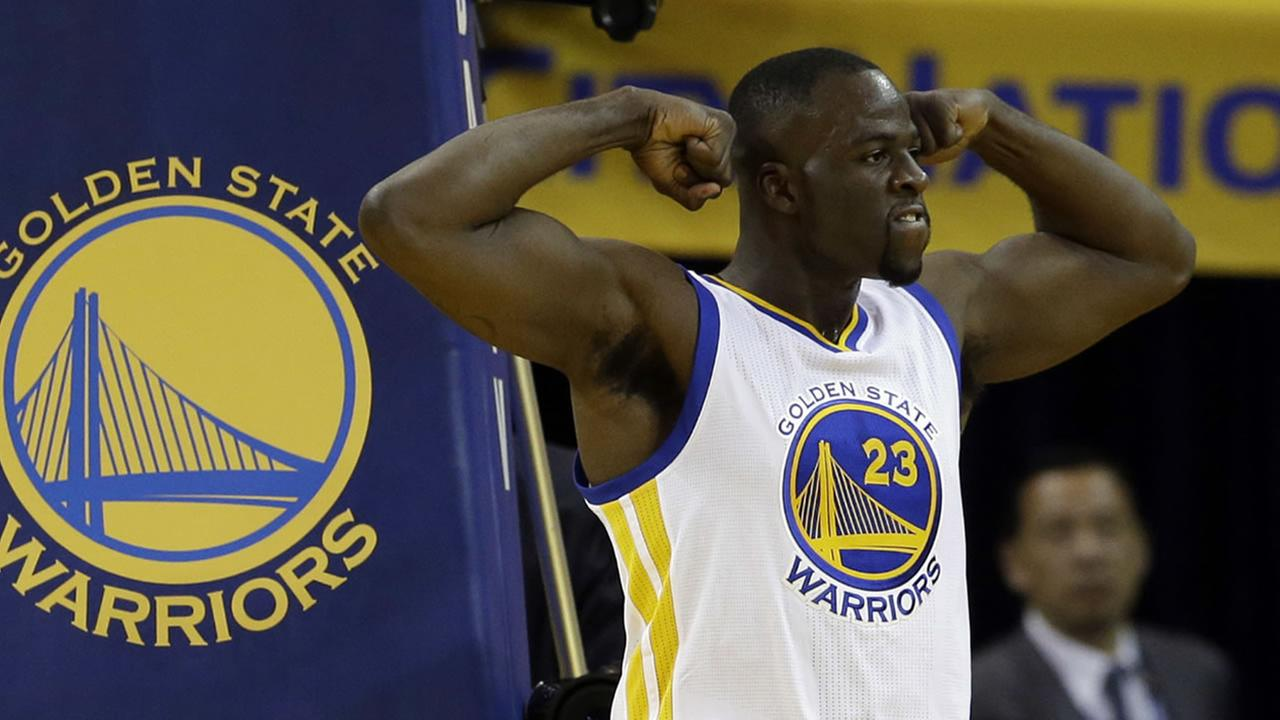 Warriors Draymond Green celebrates after scoring against the Rockets during Game 1 of their playoffs on April 16, 2016, in Oakland, Calif. (AP Photo/Marcio Jose Sanchez)
