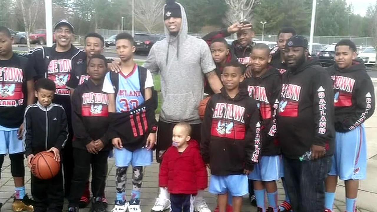Portland Trail Blazers Damian Lillard is seen with a crowd of kids in this undated image.
