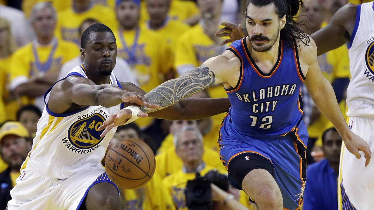 Oklahoma City Thunders Steven Adams (12) fights for a loose ball against Warriors Harrison Barnes (40) during in Game 1 of the Western Conference finals Monday, May 16, 2016, in Oakland, Calif.