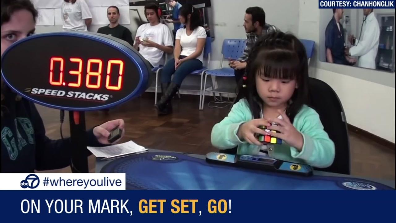 This little girl can solve a Rubiks cube in 47 seconds!