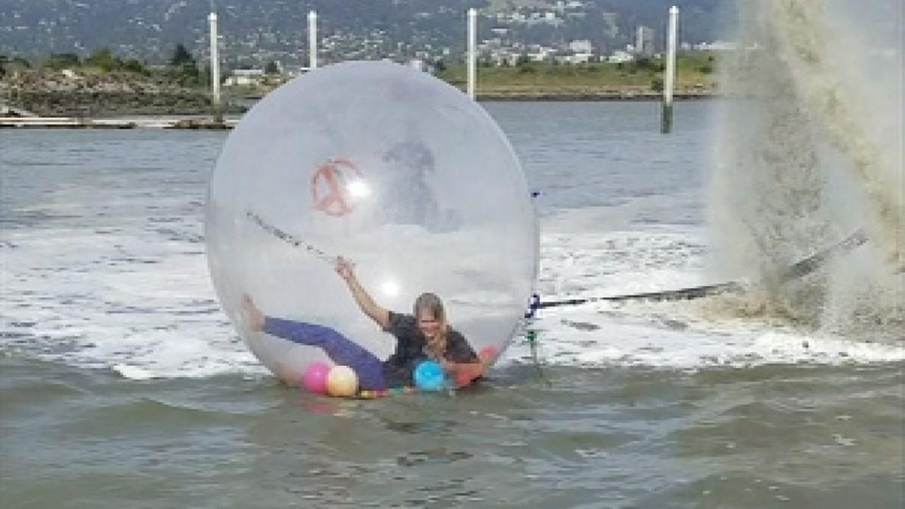 This image shows people Zorbing.