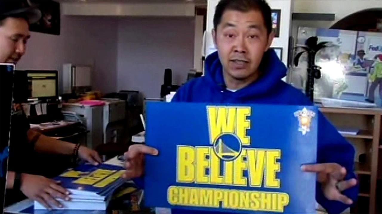 Warriors fan Paul Wong holds up a We Believe sign ahead of Game 5 against Thunder on Thursday, May 26, 2016.