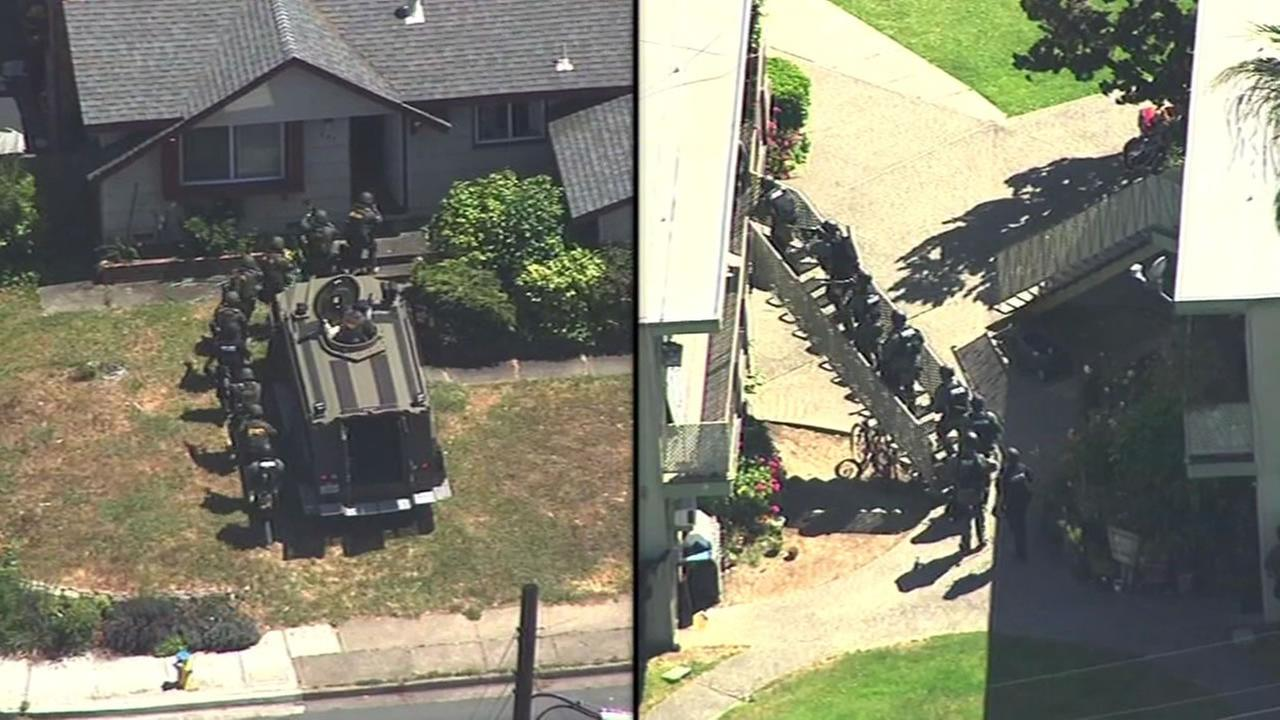 This image shows SWAT teams approaching two houses in Novato, Calif. May 27, 2016 before taking two teenage suspects into custody in connection with fatal shooting.