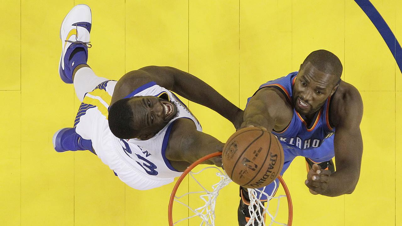 Oklahoma City Thunder forward Serge Ibaka, right, shoots against Golden State Warriors forward Draymond Green during Game 5 of the NBA basketball Western Conference Finals.