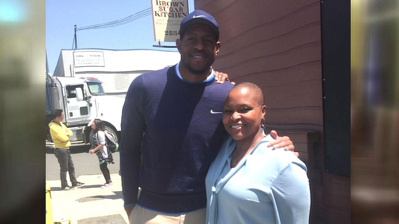 Warriors star Andre Iguodala is seen in front of Brown Sugar Kitchen with chef Tanya Holland in Oakland, Calif. in this undated image.