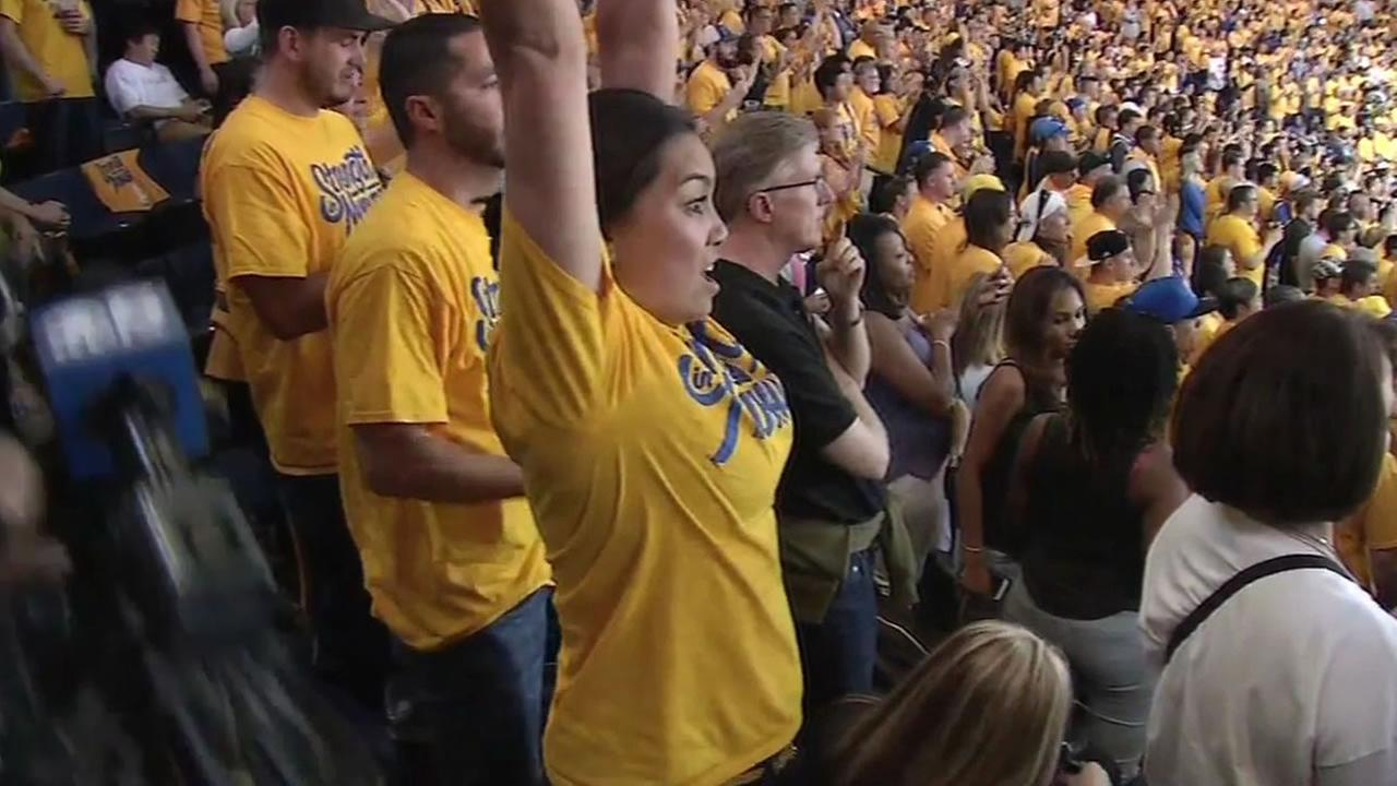 Warriors fans celebrate after Dubs make history by beating Thunder in Game 7 and advancing to the NBA Finals.