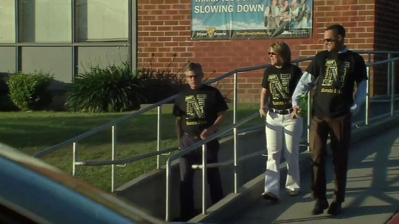 This image shows school officials outside of Novato High School.