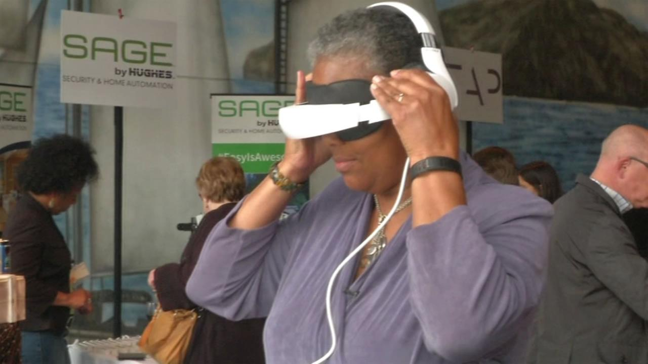 This image shows a woman wearing the Royole-X media viewer.