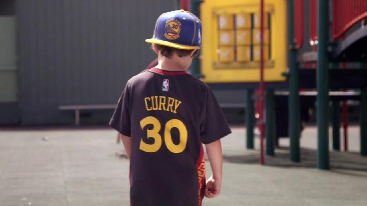 A young boy is seen wearing a Warriors star Steph Curry jersey in this undated image.