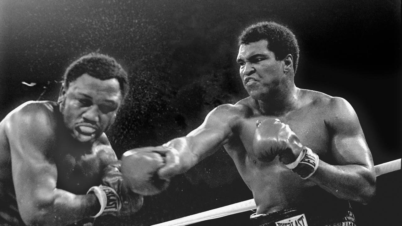 In this Oct. 1, 1975 spray flies from the head of challenger Joe Frazier as heavyweight champion Muhammad Ali connects with a right in their title fight in Manila, Philippines.