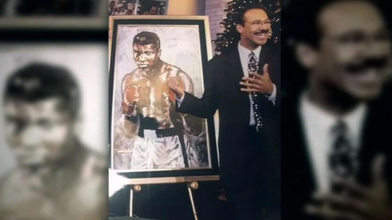 This image shows ABC7s Spencer Christian standing next to a painting that was given to him by boxing legend Muhammad Ali.