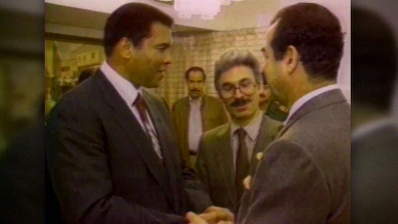 This image shows Muhammad Ali meeting with Saddam Hussein during the first Gulf War.