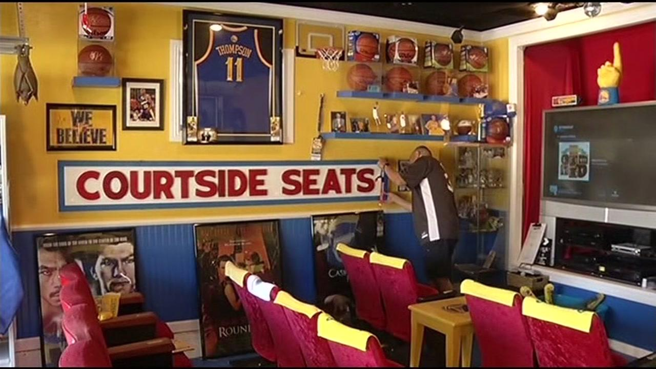 A garage is decked out with Warriors memorabilia inside a garage at a home in San Bruno, Calif.