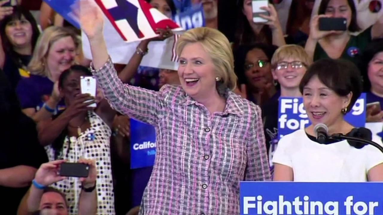 Democratic presidential candidate Hillary Clinton is seen waving in front of supporters at a rally in the Bay Area on Sunday, June 5, 2016.