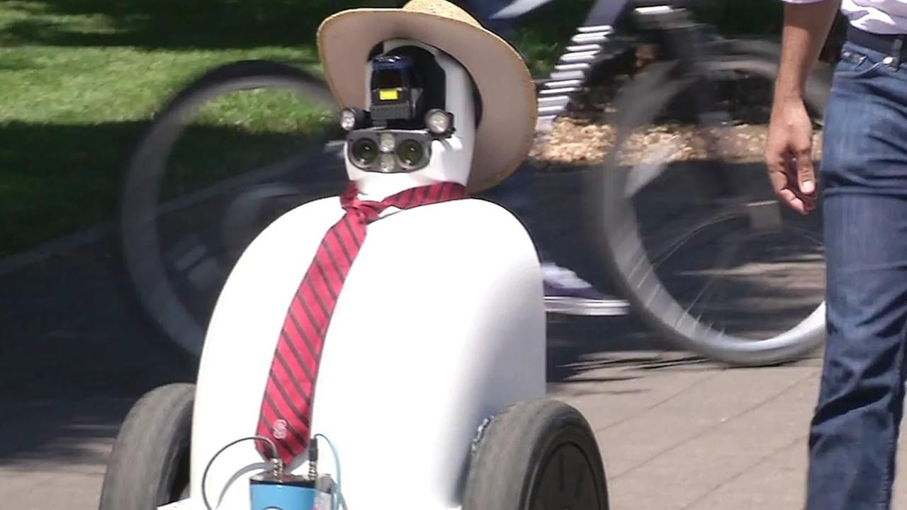A robot wearing a tie and hat is seen on Stanford Univeristy in Palo Alto, Calif. on Monday, June 7, 2016.
