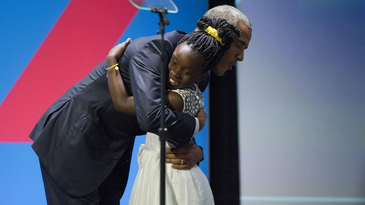 Pres. Obama hugs 11-year-old Mikaila Ulmer from Texas, after being introduced at the White House Summit on the United State of Woman, on June 14, 2016 in Washington. (AP Photo)